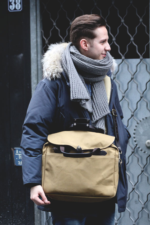 a man wearing filson original briefcase
