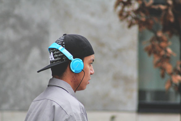 blue panasonic headphone worn by a skater