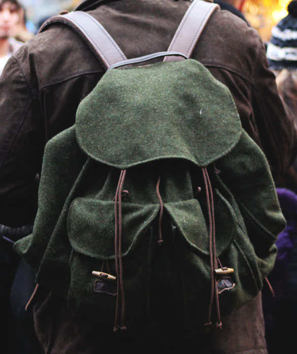 green backpack from felt and leather