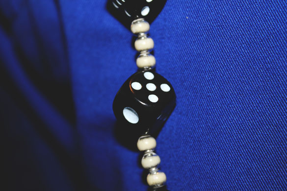wallet chain from dices in close up