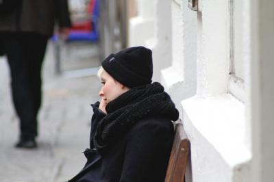 photos of black beanie and black loop scarf