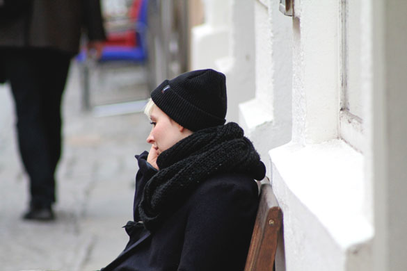 black beanie and black scarf