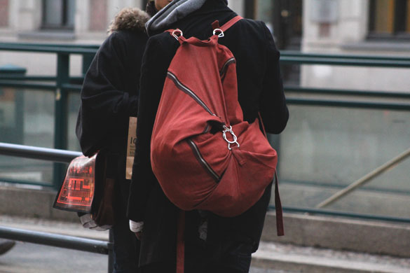 red backpack with unique cut