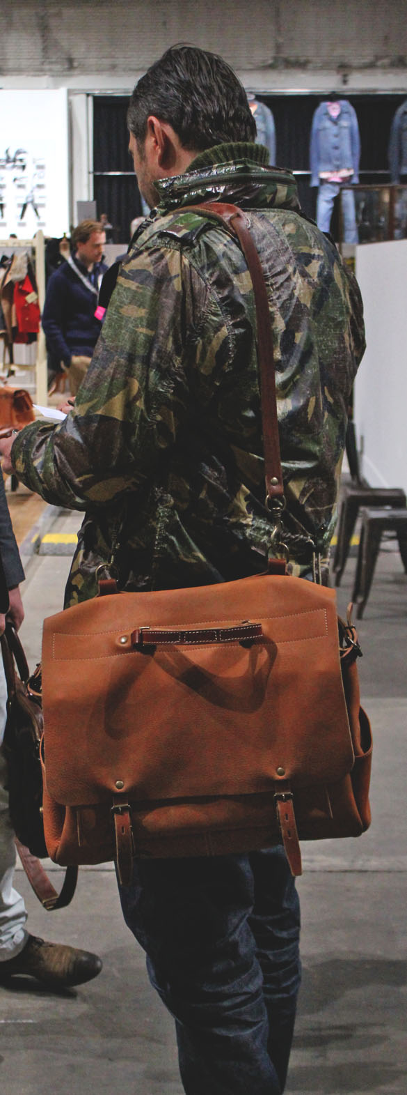 big leather briefcase and camo jacket