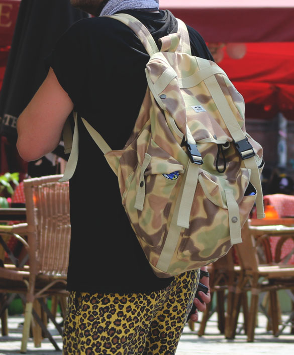 camo backpack and leopard shorts